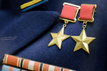 Shallow depth of field. The symbol of the highest degree of distinction between the warrior of the USSR: twice the hero of the Soviet Union. Medals of the times of the Great Patriotic War.
