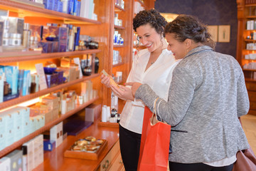 cheerful female customers choosing at a beauty store