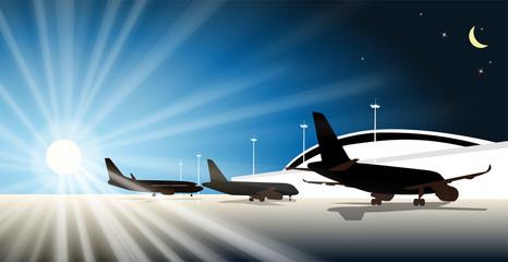 passenger planes are at the terminal at dawn