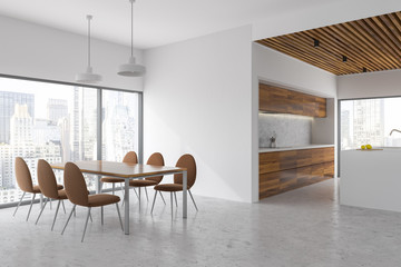 White and wood dining room and kitchen, city view