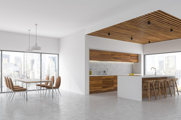 White dining room and kitchen corner, cityscape