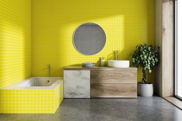 Yellow bathroom, round mirror