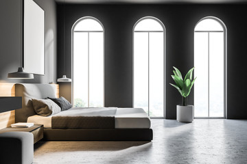 Arched windows gray bedroom with poster