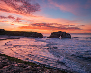 natural bridges rock bird sunrise coast ocean california colors purple blue magenta bridge waves shore dusk santa cruz travel colorful beach rocks outdoors horizon