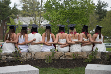 Eight senior college students are celebrating friendship after graduation