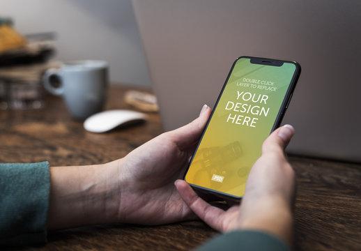 User Holding Smartphone Mockup