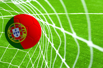 3d rendering of a soccer ball with the flag of Portugal in the net.
