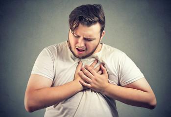 Chubby man having heart disease