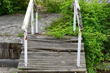 Simple still-life photo of old broken bridge in the garden