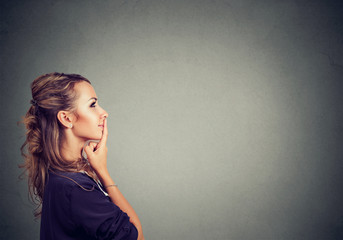 Happy thinking woman in profile