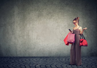 Happy woman with bags shopping online