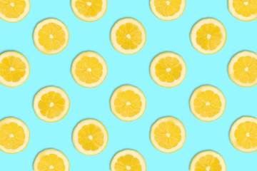 Colorful fruit pattern, Lemon slices on a pastel blue background. Top view.
