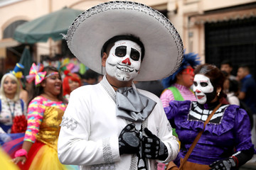 Clowns take part in a parade during Peru's Clown Day celebrations in Lima