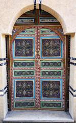 wood handmade decorated doors in Marrakech, Morocco