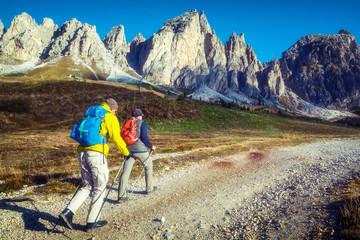 Travelers hike breathtaking landscape of Dolomites