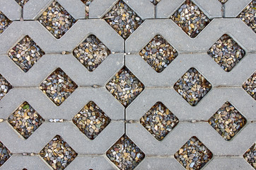the texture of the stone tile in the parking lot