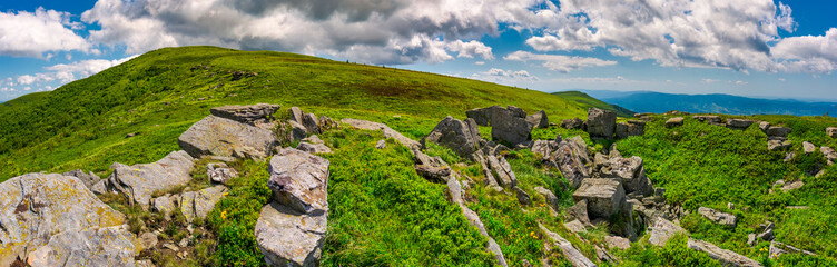 panorama of Runa mountain with rocks on hillside. gorgeous landscape of amazing Carpathian mountains on a summer day with beautiful cloudscape on a blue sky