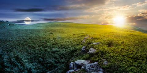 time change concept with sun and moon over panoramic landscape. lovely summer scenery with boulders among the grass. location Runa mountain, Ukraine