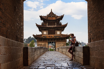 Tourist female standing on ancient Chinese bridge