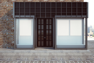 Modern storefront with blank poster