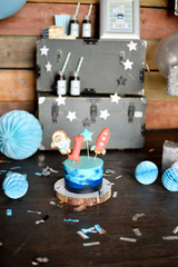 One year birthday party. Birthday in Space. Decorations for holiday party. Cake for holiday party.