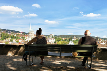 People sitting on Lindenhof hill in Zurich Switzerland