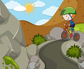 A Boy Riding a Bicycle at Mountain