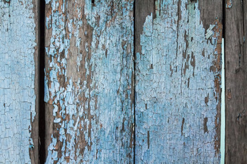 Wooden wall, old boards, peeling paint. Background. Wood texture.
