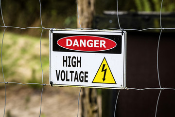 High voltage sign on a fence