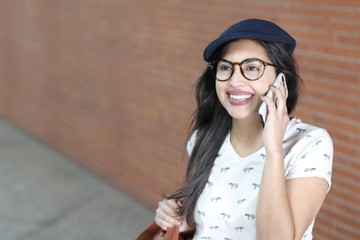 Gorgeous ethnic woman calling by phone