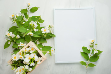 Empty frame with flowers on a light background. It is possible to use both for inscription, demonstration of fonts, and as a postcard