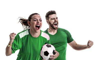 Young couple fan in green uniform celebrating