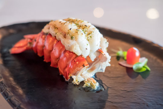 Grilled Lobster and vegetables on plate.