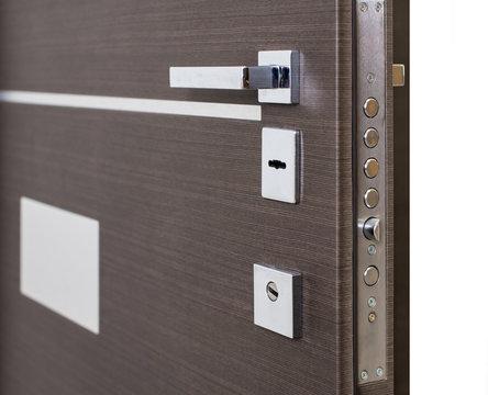 Open armored door. Door lock, Dark brown door closeup. Modern interior design, door handle. New house concept. Real estate.