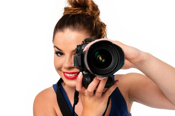Photographer occupation concept - beautiful and attractive woman holding a professional DSLR camera and smiling