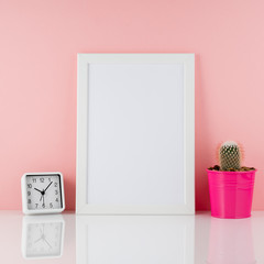 Blank white frame, plant cactus in pink pot on white table again