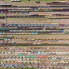 Branches of the railway at the marshalling yard, a lot of freight wagons from the height