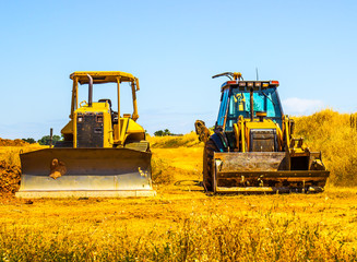 Two Heavy Bulldozers Side By Side