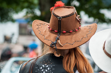 closeup of red head woman with brown cow girl hat