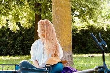 Beautiful young model relaxing in park, outdoor space, during summer days
