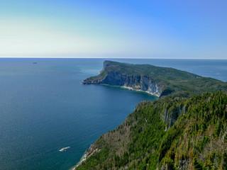 Cruise ship rounding the majestic Cape Gaspe in Forillon National Park, Canada