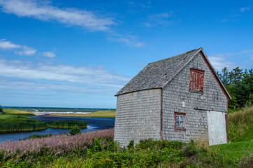 Dilapidated  wimsical maritime barn overlooking the ocean