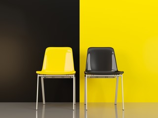 Two chairs in front of black and yellow wal