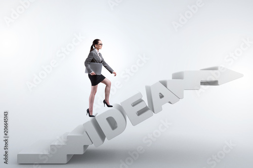 concept of idea with businesswoman climbing steps stairs stock