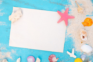 Beach background - Blank old paper with starfish, shells, coral on wood table blue sea color background. top view shot.