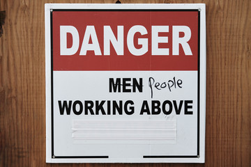 Obsolete sign on the construction site. Women's Movement for Equality