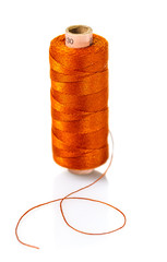 spool of orange threads