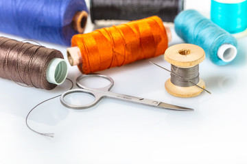 coils with colorful thread