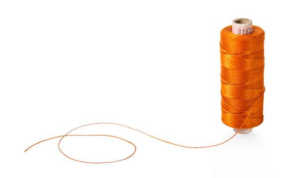 spool of orange threads