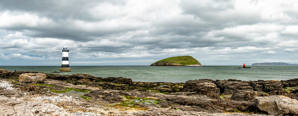 The Penmon point lighthouse is located close to Puffin Island on Anglesey, Wales - United Kingdom